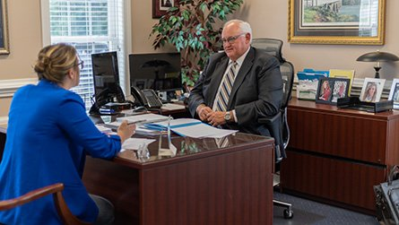 David Perry meeting with a client to discuss insurance options.