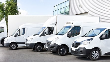 Fleet of vehicles parked in parking lot for rent or delivery